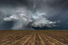 A heavy hailstorm impacts the flat and empty farmlands along the Kansas-Colorado border, near the town of Kanorado.