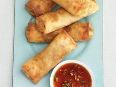 Baked Spring Rolls : A mix of crabmeat, ham and shredded vegetables fills these baked spring rolls, which trade the usual trip to the deep-fryer for a turn in the oven.