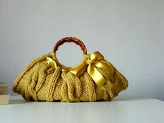 Knitted Women's tote bag, handmade purse, accessories, Knit Handbag, mustard gold, autumn, winter Bag, christmas gift, gold bow. $65.00, via Etsy.