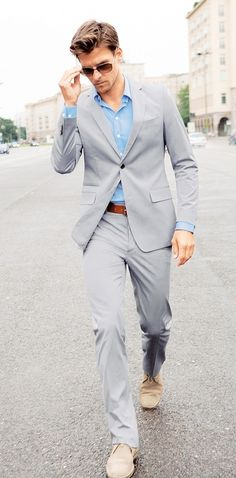 Shop this look for $226:  http://lookastic.com/men/looks/longsleeve-shirt-and-suit-and-belt-and-sunglasses-and-desert-boots/3147  — Light Blue Longsleeve Shirt  — Grey Suit  — Brown Leather Belt  — Dark Brown Sunglasses  — Beige Suede Desert Boots
