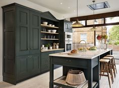 Teddy Edwards Brooklands range with island, raised-bar seating and traditional dresser-style shelving
