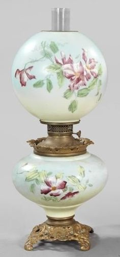 An American reticulated and white opal glass kerosene parlor lamp, Gone with the Wind style. Gilded cast iron based sky-blue enamel lamp in Primrose decor, retains the blown glass chimney and matching spherical floral-enameled white opal shade. America, circa 1875-1900