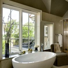 Love the placement of the tub next to the window with a big window sill.