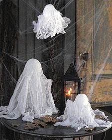 Mini Cheesecloth Ghosts DIY attached thanks to Martha Stewart
