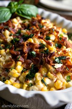 Corn and Bacon Casserole - Fresh corn kernels and bacon in a light and creamy sauce that has been flavored with garlic and basil.