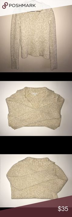 """Tommy Hilfiger Cable Knit Cream Sweater XL Beautiful Tommy Hilfiger Cable Knit Sweater. Cream/beige in color. 62% Cotton 38% Acrylic, gently used no holes, tears, stains, or pilling. Heavier in weight. Approximate measurements: 23.5"""" shoulder to hem, 19"""" pit to pit, 26"""" Sleeve. Make me an offer 💕 Tommy Hilfiger Sweaters V-Necks"""