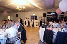 Flower Wall Light up LOVE letters on the dance floor in Rathsallagh House. Need some dance floor inspiration? Function Room, Greggs, Flower Wall, Light Up, Wedding Venues, Wall Lights, Floor, Letters, Dance