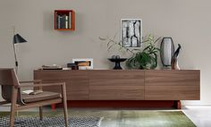Living room wooden wall unit with sleek, minimal design