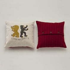 Egg Press Heraldry Throw Pillow $80. From Schoolhouse Electric. Love the plaids