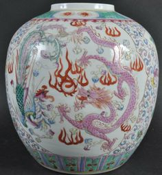 AN EARLY 20TH CENTURY CHINESE PORCELAIN ENAMELED AN EARLY 20TH CENTURY CHINESE PORCELAIN ENAMELED GINGER JAR, Guangxu, bearing Qianlong marks to base, painted with dragons. 9ins high.