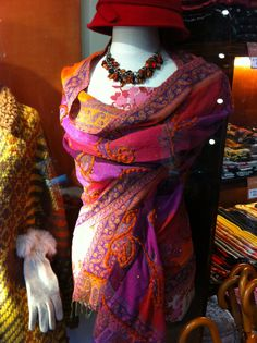 Love the rich colors & textures in this Brussels shop window  #scarves #shopwindow