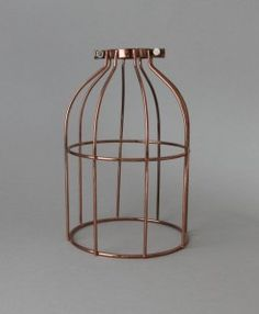 Our copper cage light shade takes a stunning filament light bulb and fabric cable pendant to new style heights, the perfect nod to the copper interior trend
