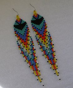Beautiful beaded dangle peyote earrings with fringe.Native American style, Boho style. Earrings made from Czech beads. surgical Steel ear wires. Measurements: Length - 15 cm (including ear wires) Width - 2.5 cm more earrings here http://www.etsy.com/shop/Olisava?section_id=14128476