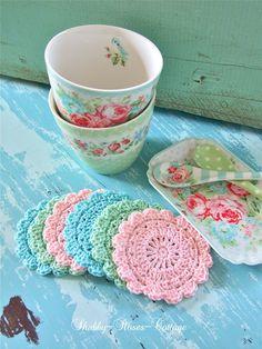 springtime coasters : crochet pattern in pretty colors (at Shabby-Roses-Cottage) Crochet Kitchen, Crochet Home, Love Crochet, Crochet Crafts, Crochet Projects, Knit Crochet, Thread Crochet, Beautiful Crochet, Crochet Puff Flower