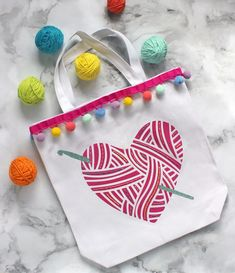 Make an adorable custom tote bag by combining hand embroidery and heat transfer vinyl. This fun craft idea combines several of my favorite things… embroidering, using my Silhouette machine, and knitting & crochet! I created this cheery tote bag to hold my yarn when I'm working on a crochet or knitting project. This post contains … Easy Yarn Crafts, Fun Crafts, Diy Craft Projects, Project Ideas, Vinyl Projects, Diy Tote Bag, Custom Tote Bags, Silhouette Cameo Projects, Crochet Yarn