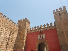 The Lion Gate of the Alcazar in Seville, Spain.