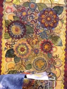 The gorgeous flowers on this quilt are hand-dyed doilies