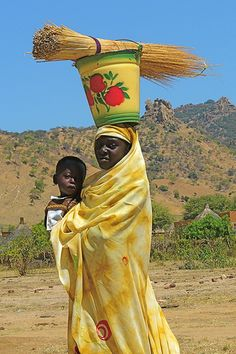 Africa- Portrait of a woman carrying a child and a bucket on her head, Sudan. Photo by Rita Willaert. African Tribes, African Women, We Are The World, People Around The World, Beautiful World, Beautiful People, Out Of Africa, Africa Art, West Africa