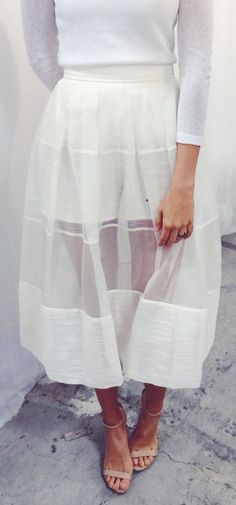 Try the sheer trend. Pair a sheer white midi skirt with a white top and heels. This trend works best in monochrome.
