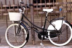 Charming italian bicycles...LOVE the basket!