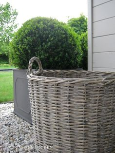 grey willow baskets, lead planters, pale gravel and topiary via Room Seventeen: Garden