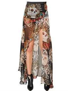 This is one of the rare times I like the high front, low back of a garment. It's the sharp, angular cut that does it for me with this one. John Richmond Skull print silk chiffon skirt