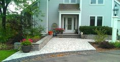 front entrance in pavers with seat walls, steps, porch and bluestone caps
