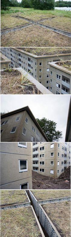 "Nordkreuz urban art building installation, ""about 9*9m, 1.5m deep,  wood, eternit, spray paint, sweat, dockville, hamburg in 2011.""   http://www.flickr.com/photos/evoldaily/5984235778/"