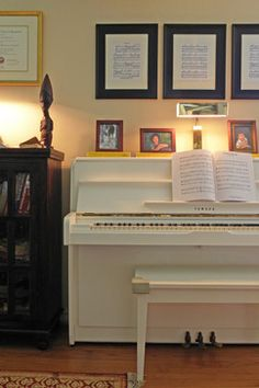 Framed sheet music above piano. Look through Mom's collection. Dallas, TX: Stanford & Corrine - traditional - family room - dallas - Sarah Greenman