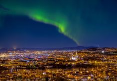 Lovely nordlys (northern light) over the beautiful Trondheim - www.aziznasutiphotography.com                   A view from utsikten in Trondheim in a very beautiful night.