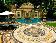 The 24k gold inlaid pool with mysterious dial mosaic at Versace's old villa.