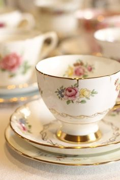 Pink and yellow roses on a white porcelain cup with gold trim.  http://www.rosemary-bb.com/bed-and-breakfast/afternoon-tea-at-rosemary-house/