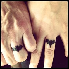 Batman/Batgirl wedding ring tattoo. My husband and I decided to get these for our 3 year anniversary. It is completely unique to us. Nothing says love like batman and batgirl :-).