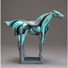 Jeri Hollister Turquoise Tribute Horse Ceramic Sculpture ($850) ❤ liked on Polyvore featuring home, home decor, turquoise home accessories, handmade home decor, turquoise home decor, horse home decor and ceramic horse sculpture