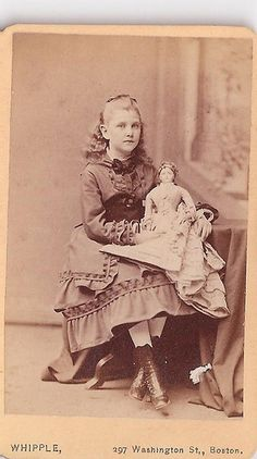 Girl with french fashion doll - Boston. Interesting how the dolls were imported from France and wound up all over the United States....and the world.