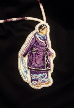 holy....*Gathering Sky* beadwork Whoever beaded this is EXTREMELY TALENTED! They added beaded moccasins to their beaded medallion....... and look at the scarf she's holding!!