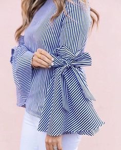 Gotta earn your stripes, babe, and there's no better way to own them than this dramatic Charisma top with bell sleeves, ruffles and self-tie bows. - Bell Sleeves with Self-tie bowknot and ruffles - Spilt cuffs - Concealed back zip closure - Not lined - 100% Cotton - Hand wash Size(cm)Length Bust Shoulder Sleeves XS/S 61 90 37 58 M/L 62 94 39 59 XL 63 98 41 60 Size...