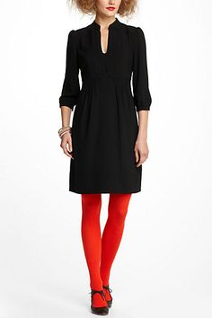 The dress is whatever - I just love the red tights with black dress and shoes! Leona Tunic Dress #anthropologie