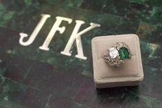 This is Jackie's actual engagement ring. She had it reset in 1962 and added marquise and round diamonds to the original Van Cleef and Arpels simple twin emerald and emerald-cut diamond. This is the correct ring- not the one so many websites show with a big emerald in the center and diamonds around it.