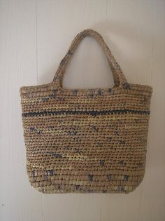 made with plarn   ( plastic bags cut into strips and crocheted...! )