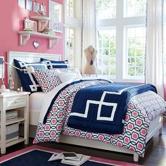 Great colorful girl's room idea from  PB Teen Pink and Navy.. Love those shelves!
