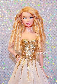 taylor swift barbie doll. in one of my favorite award show dresses. i kind of need this in my life. hahaha
