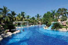 ClubHotel Riu Jalisco 5* All Inclusive - Riviera Nayarit - Mexico | Slide Into The Sparkling Water Of One Of The Swimming Pools | View Vacation Packages!