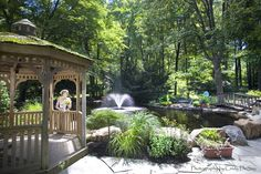 Gorgeous pond, patio, gazebo and plantings are a focal point on this Bucks County property by Mark Bryan Designs.