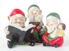 Vintage Homco Christmas elves are so sweet! The collectible ceramic figurines are ready to pack up their creations!