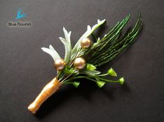 Wedding boutonnieres feather boutineers rustic green by Rationale