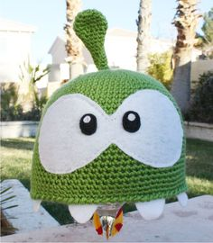 Om Nom Omnom Inspired  Hat with Teeth and Candy: Cut the Rope -ish Green Monster Korean App Videogame Kawaii Handmade Crochet Cosplay Beanie. $32.00, via Etsy.