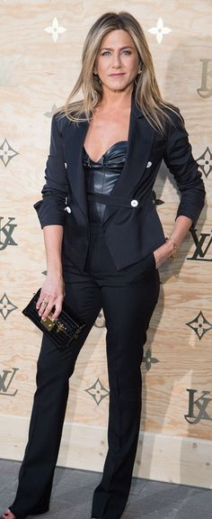 Who made  Jennifer Aniston's black pants, jacket, sweetheart top, and clutch handbag?