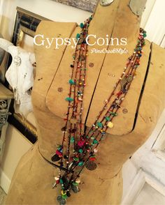 Gypsy Coins....handcrafted, hand crocheted beads of turquoise, silver, glass and faux coins ....fashioned & created by PineCreekStyle..,,
