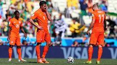 Robin van Persie (C) and Arjen Robben (R) of the Netherlands react after conceding t